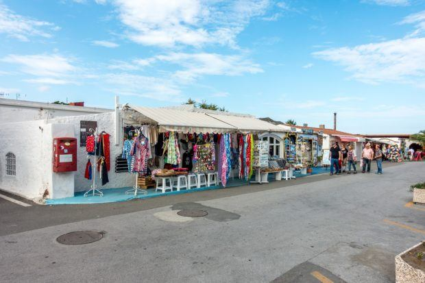 Visiting the beach town of Porto di Levante on Vulcano Island.  There are a handful of shops for shopping and also a wine shop where you can sample Italian wine.