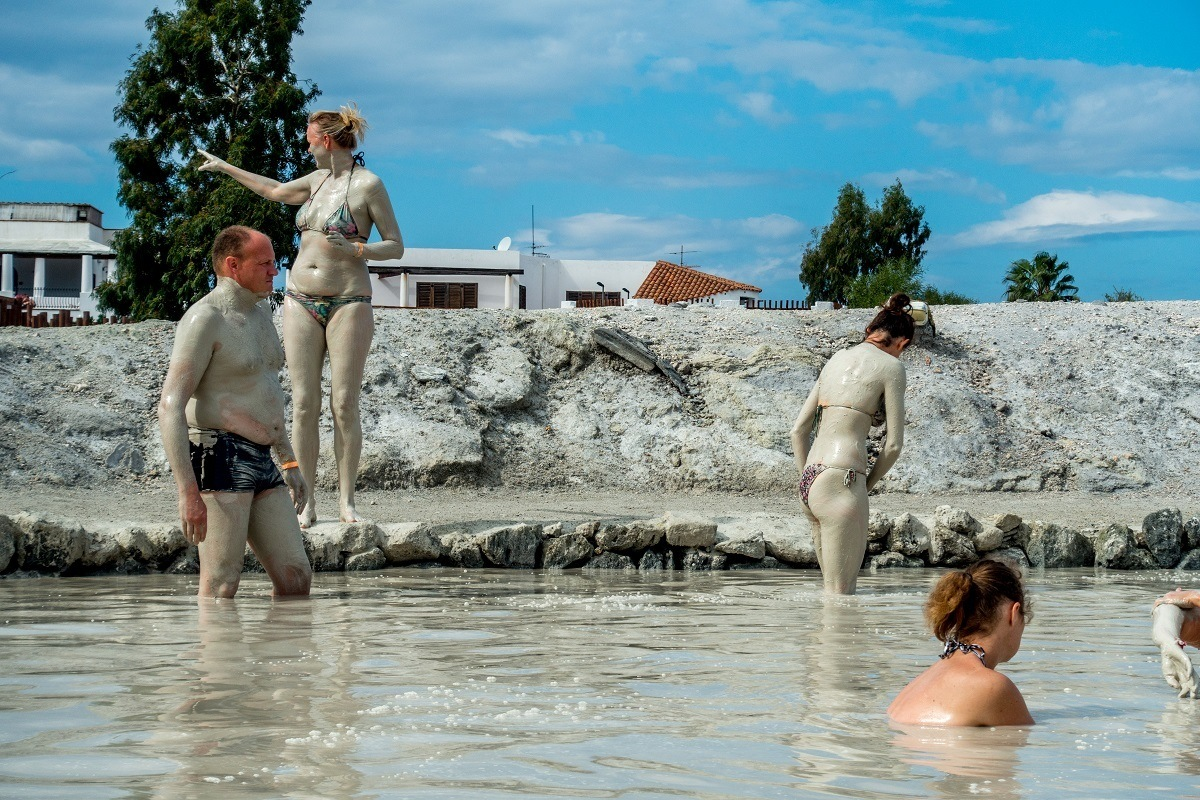People coating their bodies in mud and silt