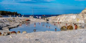 Everything you need to know to visit the Vulcano Island mud baths in Italy. This includes things to do on Vulcano Island, how to get to Vulcano Island, tips for visiting the mud baths and hot springs, and also how to get to the black sand beach.