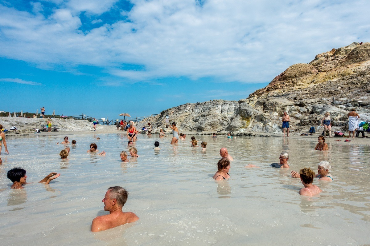 People enjoying the thermal mud bath and hot sulfur spring waters