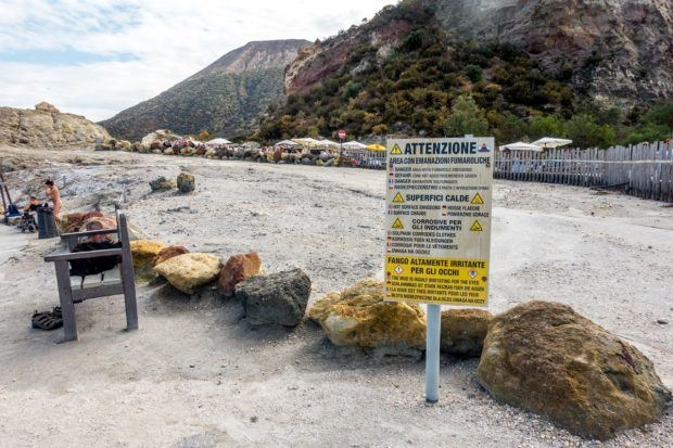 Advisory notices are prominently placed around the mud baths on Vulcano Island (Laghetto di Fanghi).