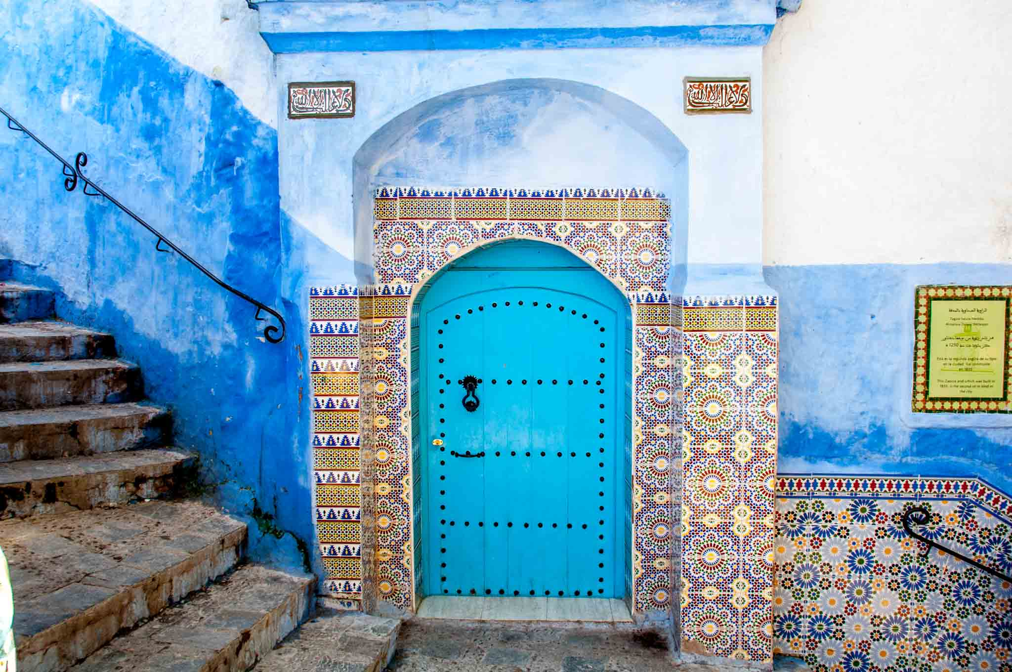 Blue door and tilework in Chefchaouen, Morocco