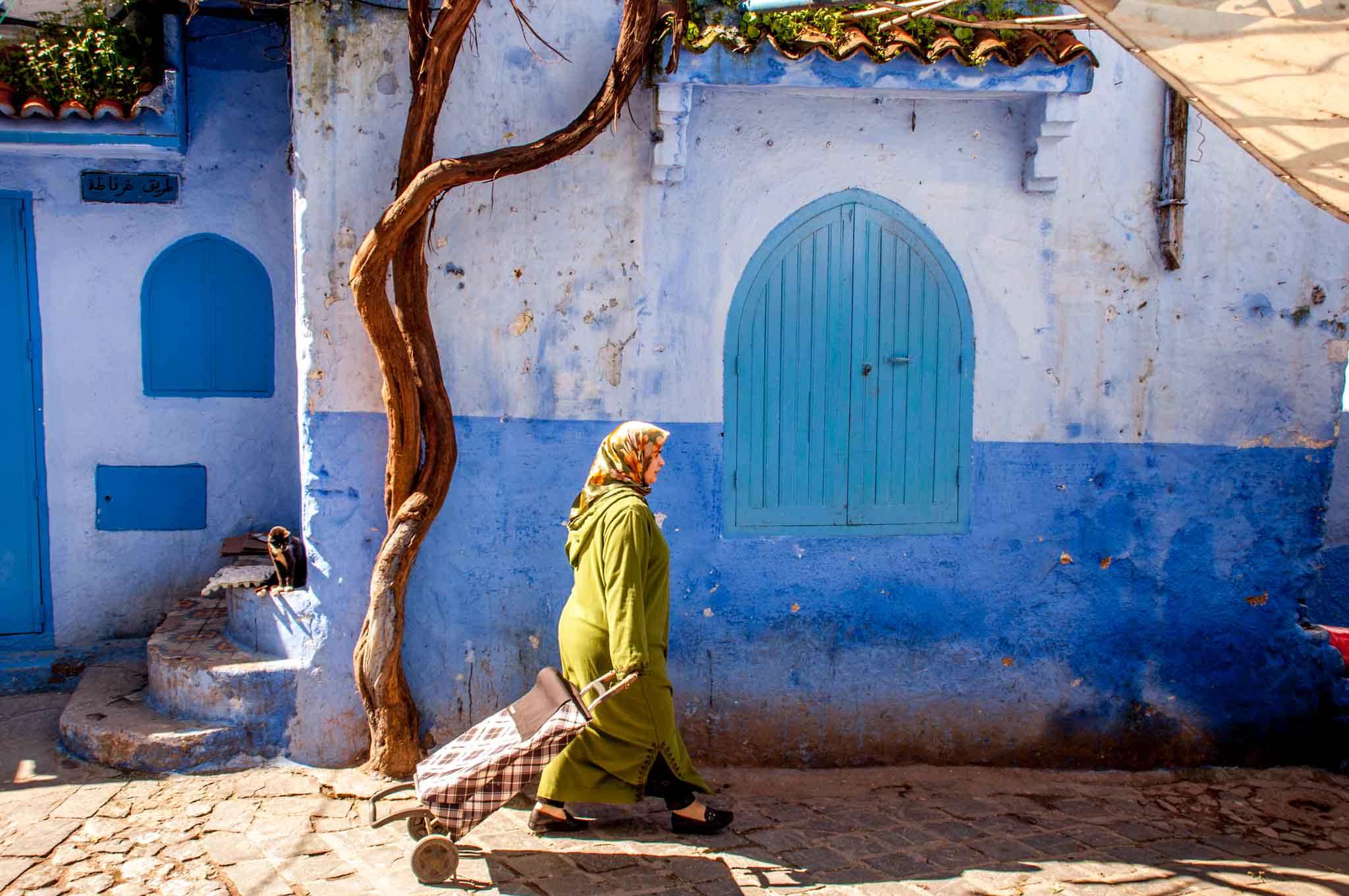 Woman walking in Chefchaouen, one of the best Morocco destinations