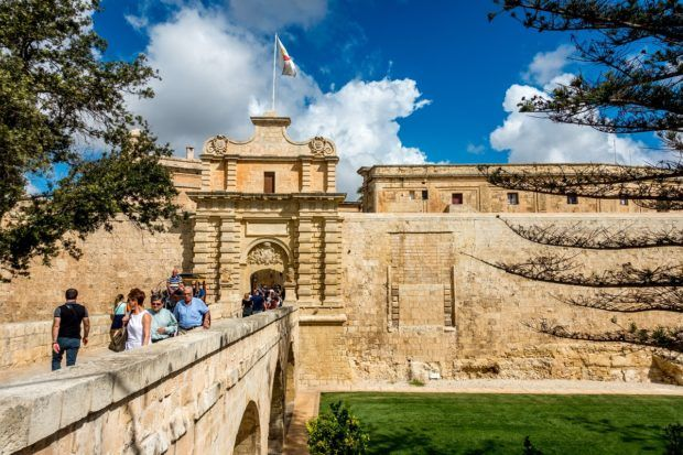 Crossing through the main gate of Mdina, Malta. A visit here is one of the top things to do in 4 days in Malta.