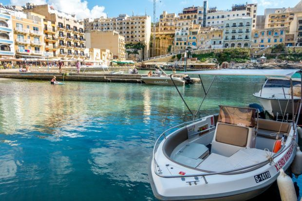 Boat in Xlendi bay in Gozo off the coast of Malta
