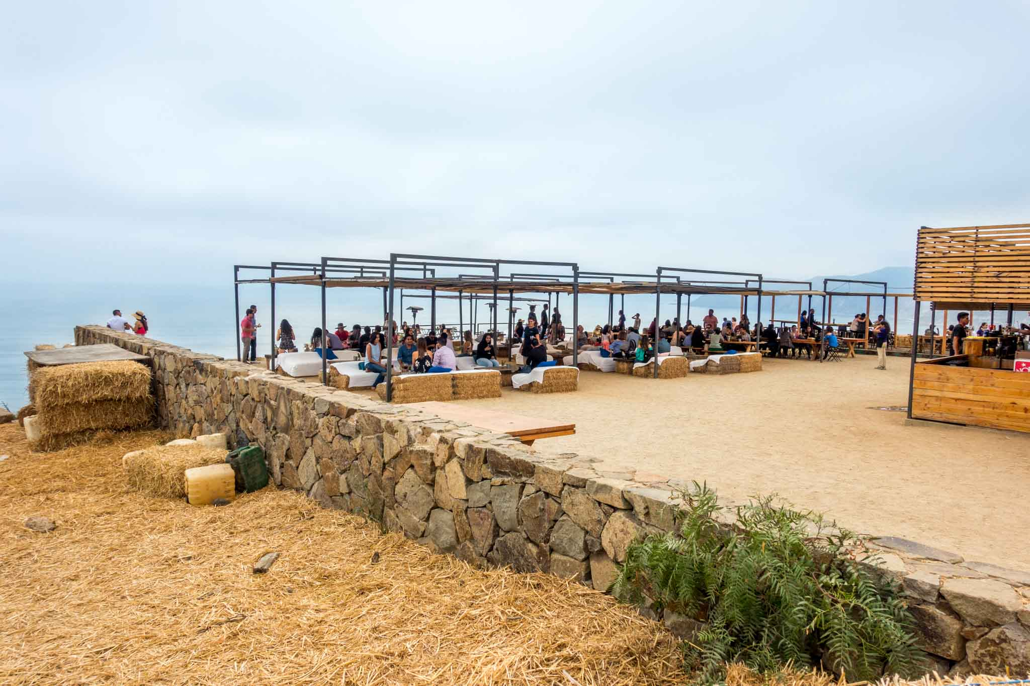 People enjoying views of the Pacific Ocean from Bar Bura at Cuatro Cuatros