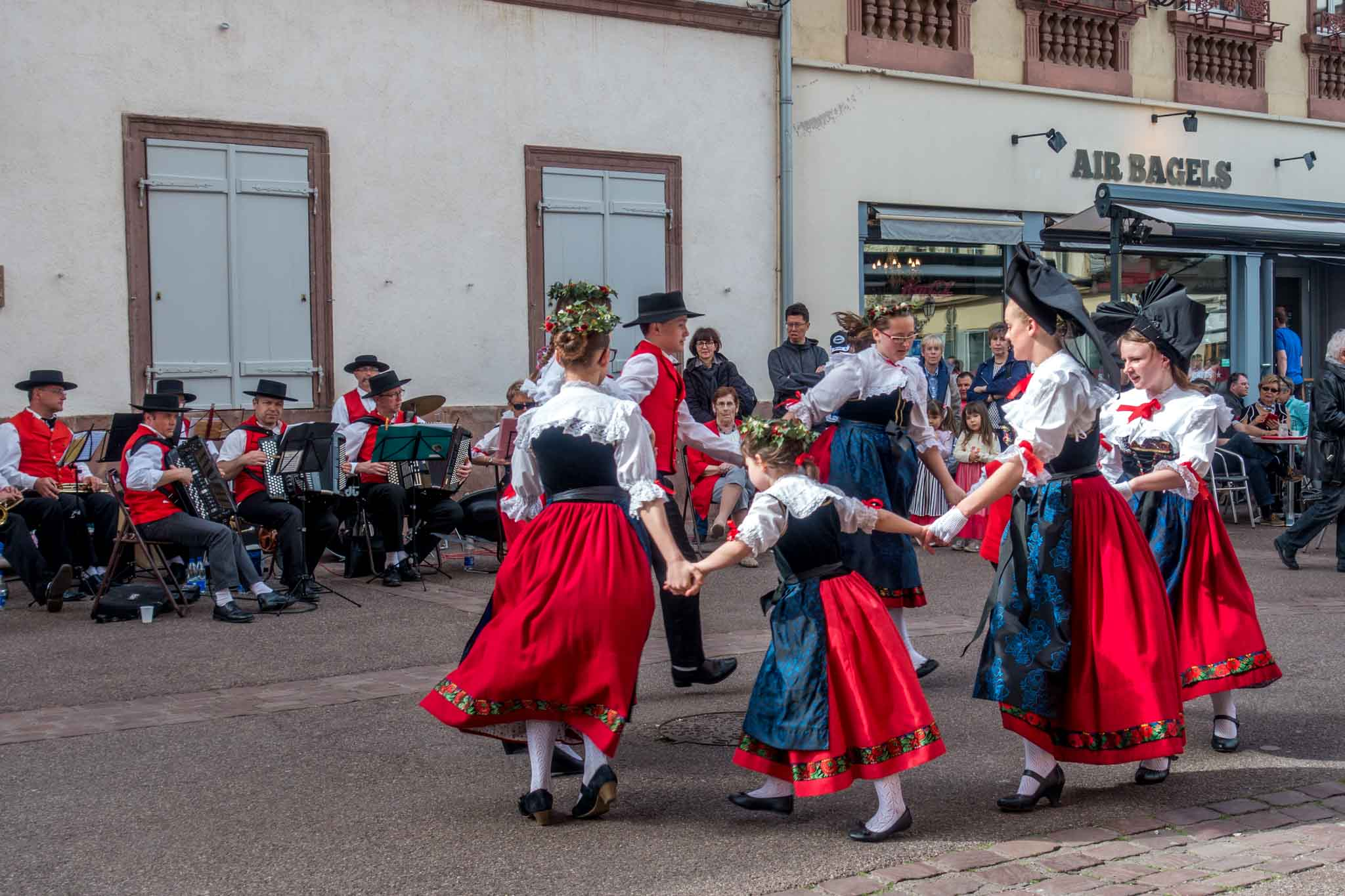 People dancing in traditional Alsatian clothing