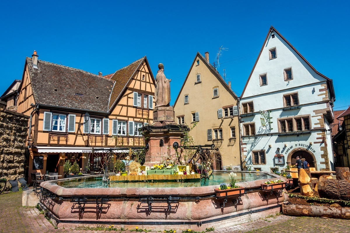 Fountain and buildings in town square on the Alsace wine route