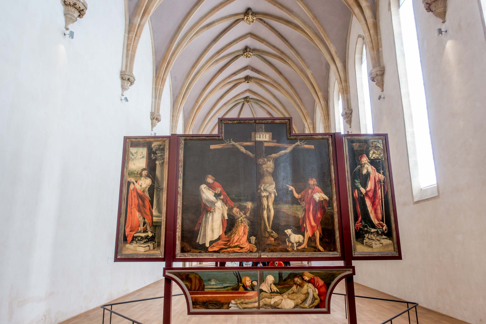 Isenheim Altarpiece painting of Jesus being crucified