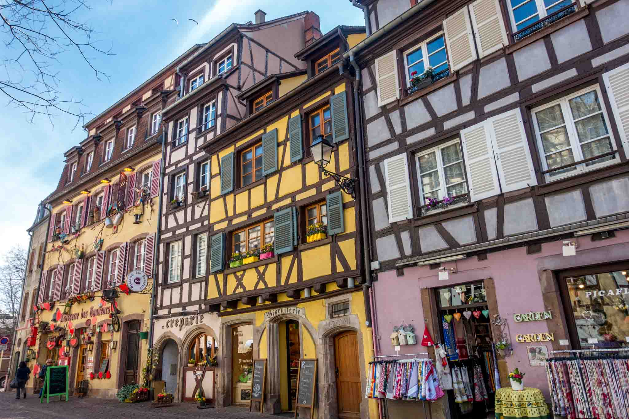 Shops along colorful Rue des Tanneurs in Colmar, France