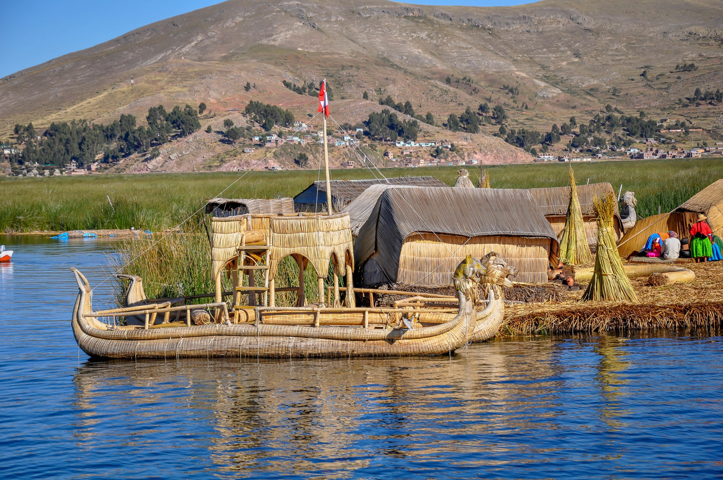 Reed boats and the manmade Uros Islands made of reeds floating in Lake Titicaca