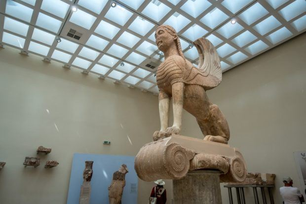 Delphi travel guide:  The Spinx of Naxos in the Delphi Archaeological Museum.  This is one of the many figures from Delphi Greek mythology in the museum.