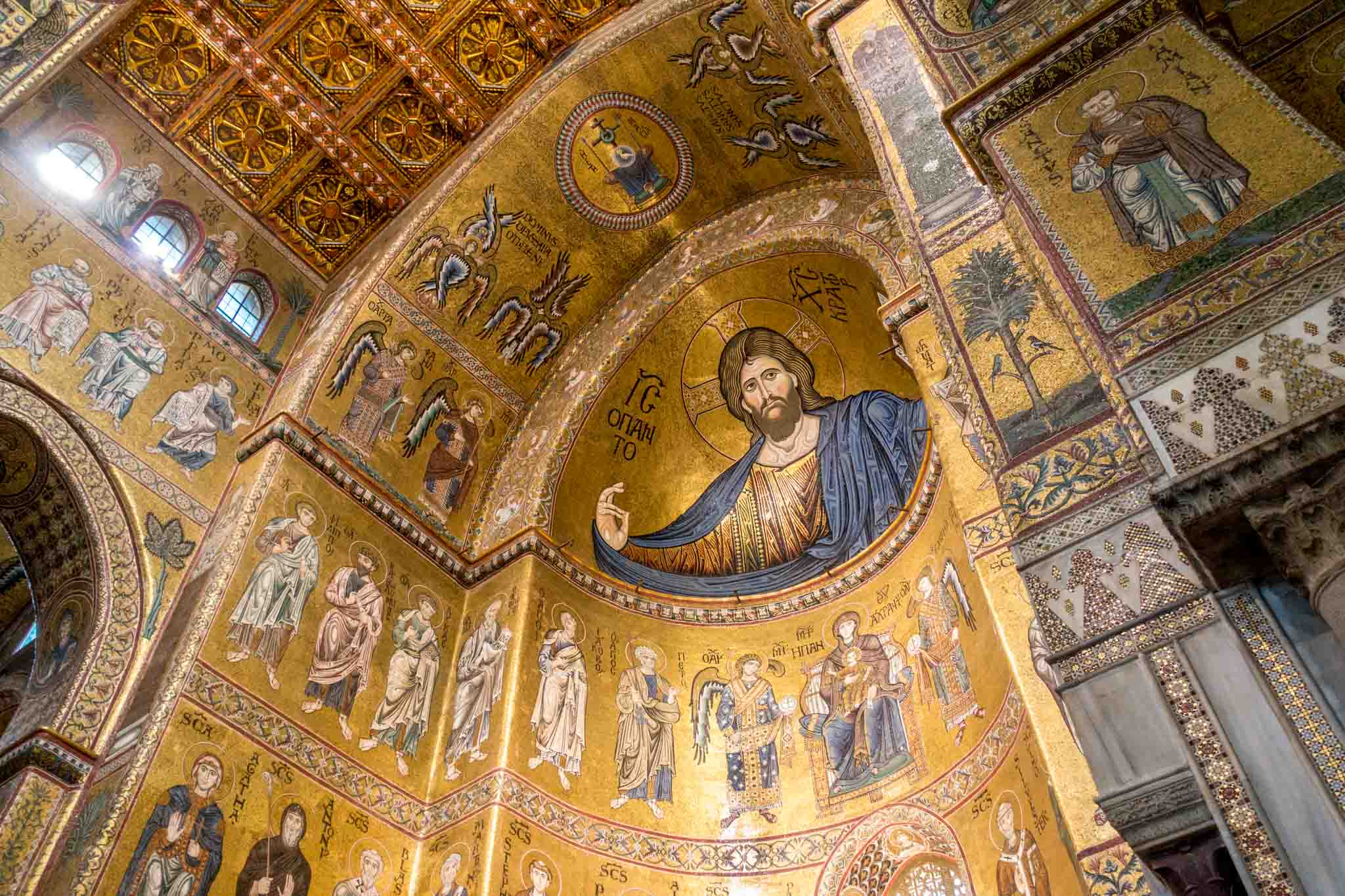 Large tile and gold mosaics of Jesus and the saints in Monreale, Sicily