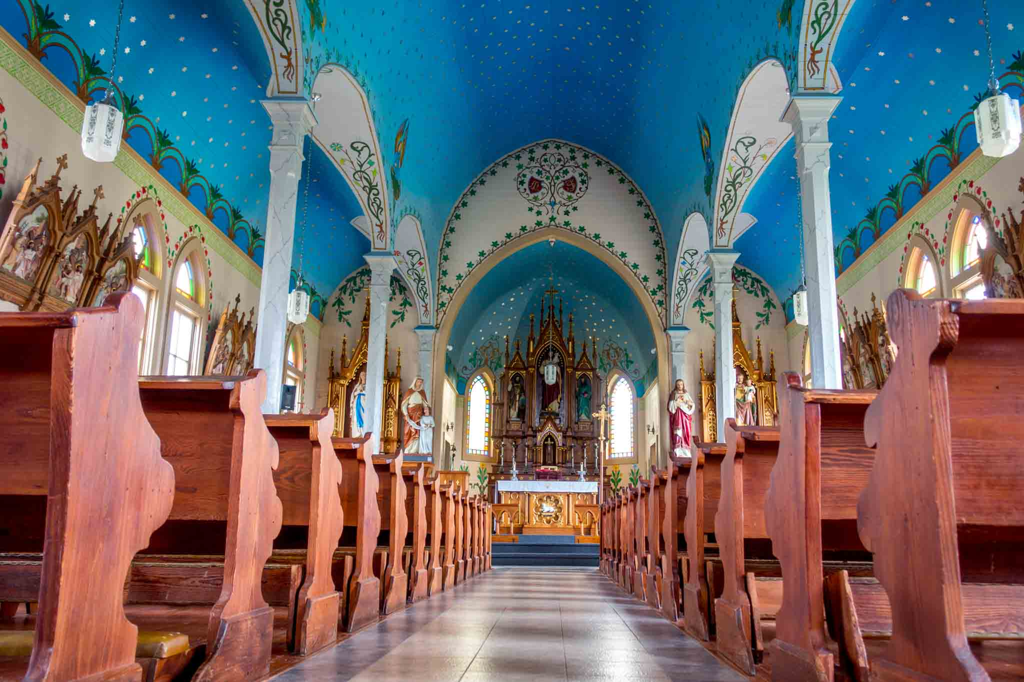 Church interior with a blue ceiling painted with stars