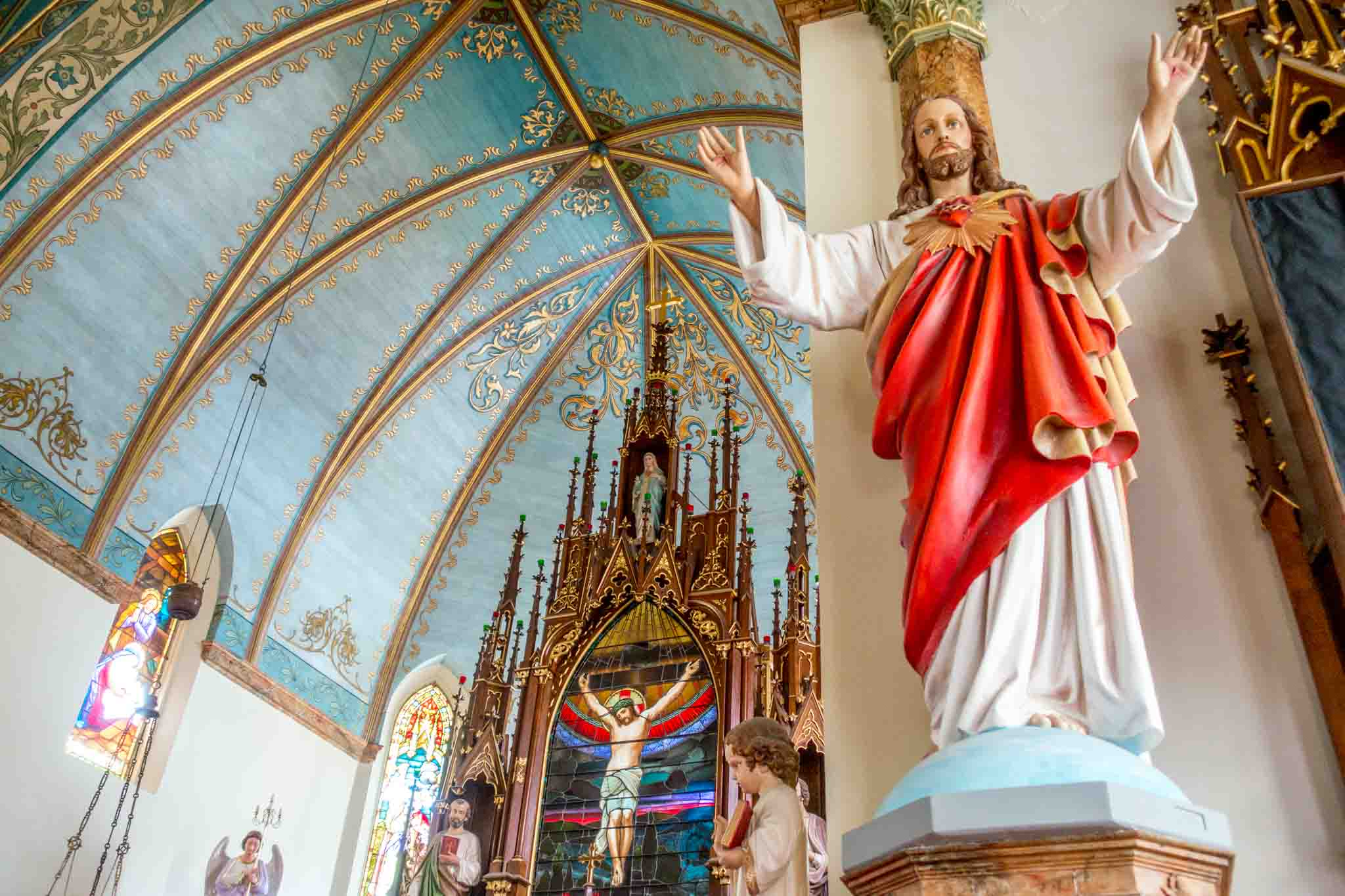Statue of Jesus and altar in one of the painted churches of Texas