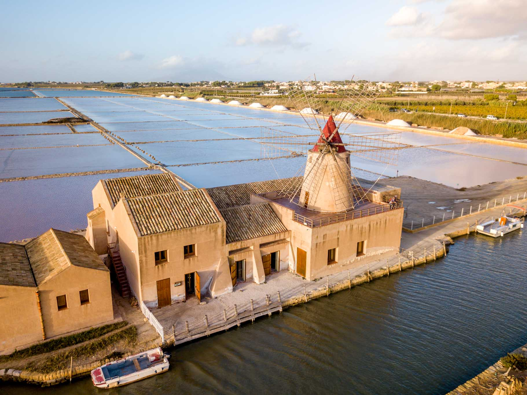 Overhead view of the salt flats of Trapani and a salt mill
