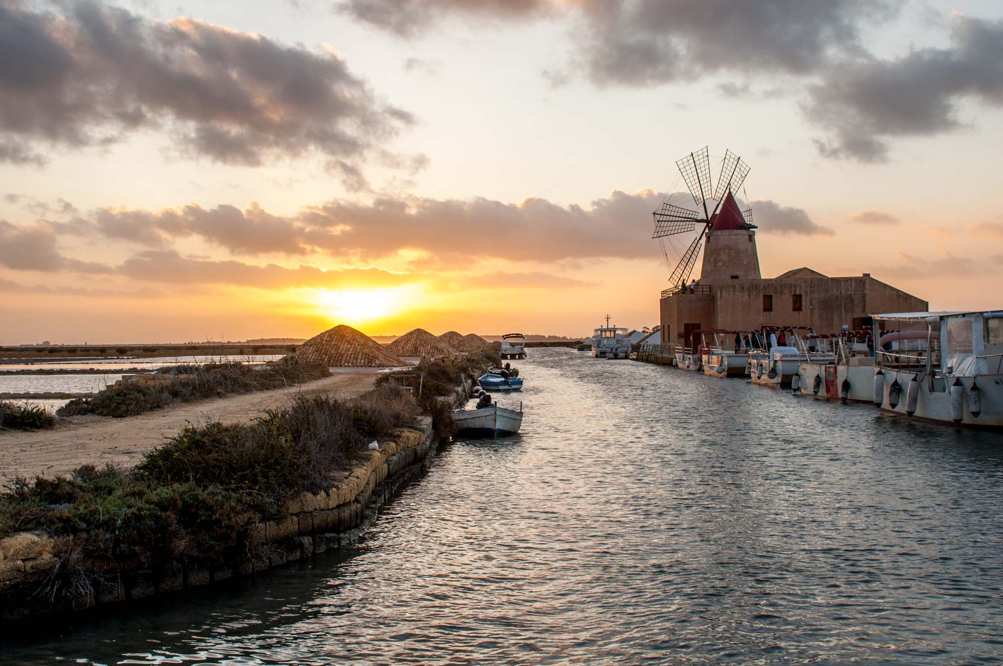 Salt mill and sea at sunset in Trapani, Sicily