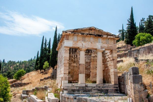 Delphi Greece photos:  The reconstructed Treasury of the Athenians housed gifts and dedications from visitors.  The building was reconstructed from the remains of the Athenian Treasury and the Siphnian Treasury.  The Treasury of the Siphnians no longer exists.