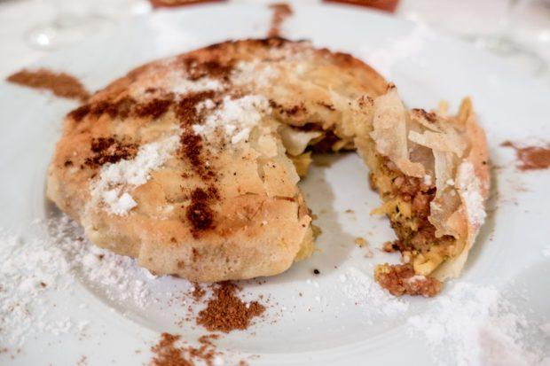 Cinnamon-topped pastilla is worth a try when you travel to Morocco