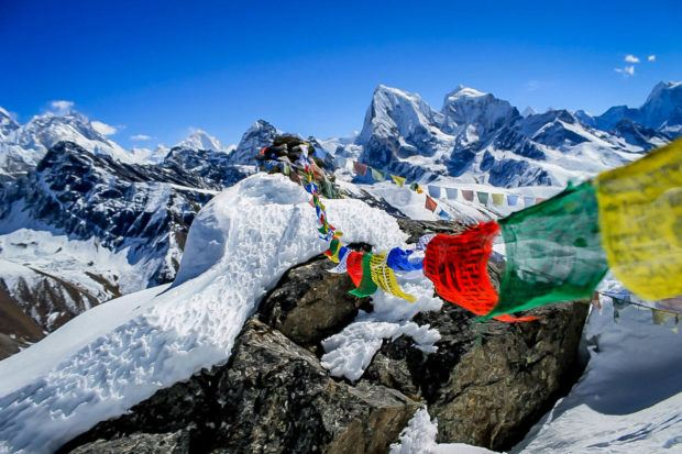 Trekking in Nepal Himalaya Photos:  Prayer flags on Annapurna.  What is trekking?  It is an extended multi-day hike where sherpas carry your gear.  Photo courtesy of Susan Green.