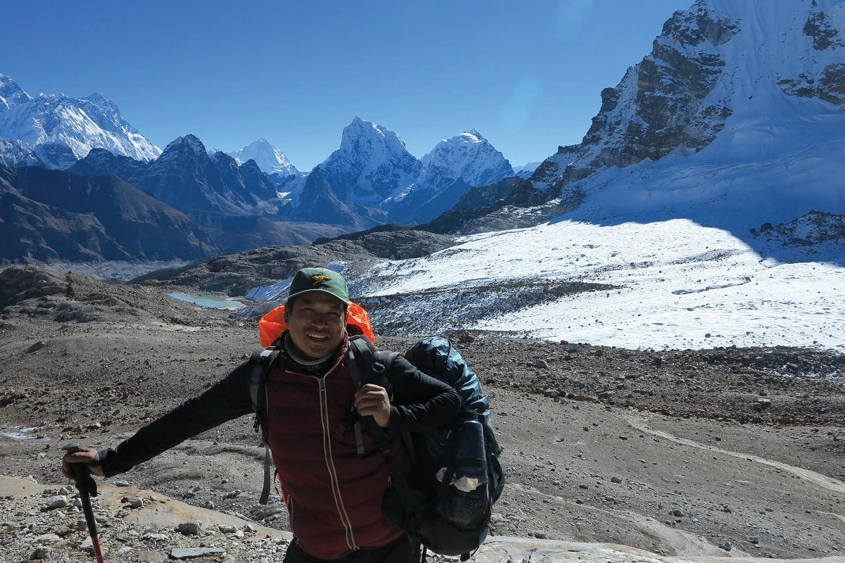 A sherpa guide in the mountains of Nepal.  The Sherpa meaning is both a professional occupation as well as an ethnic group in the Himalayas.  Sherpas guide clients through the mountains and carry much of their gear.  Photo courtesy of World Expeditions.