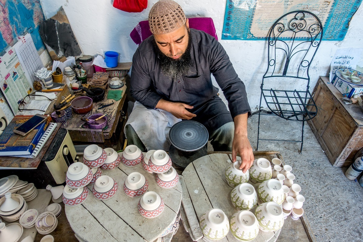 A Morocco travel guide can guide you toward unique experiences like watching pottery making in Fez
