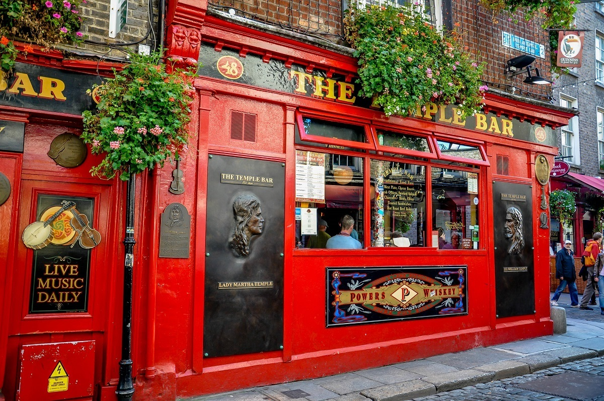 Red exterior of Dublin's Temple Bar, a highlight of a driving in Ireland itinerary 7 days