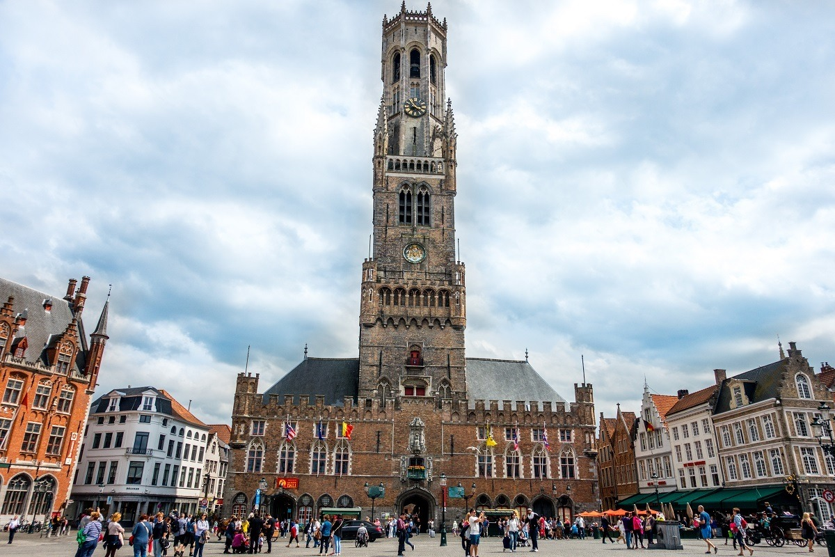 On a day trip to Bruges, Belgium, visit Markt Square and the bell tower