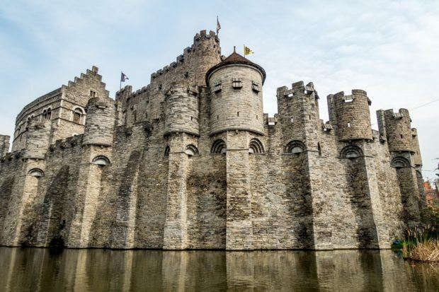 Imposing Gravensteen (also known as the Castle of the Counts or Ghent Castle) looms above the Lys River in Belgium