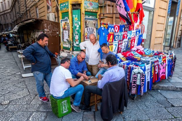 Men playing cards at Vuccaria market in Palermo Italy