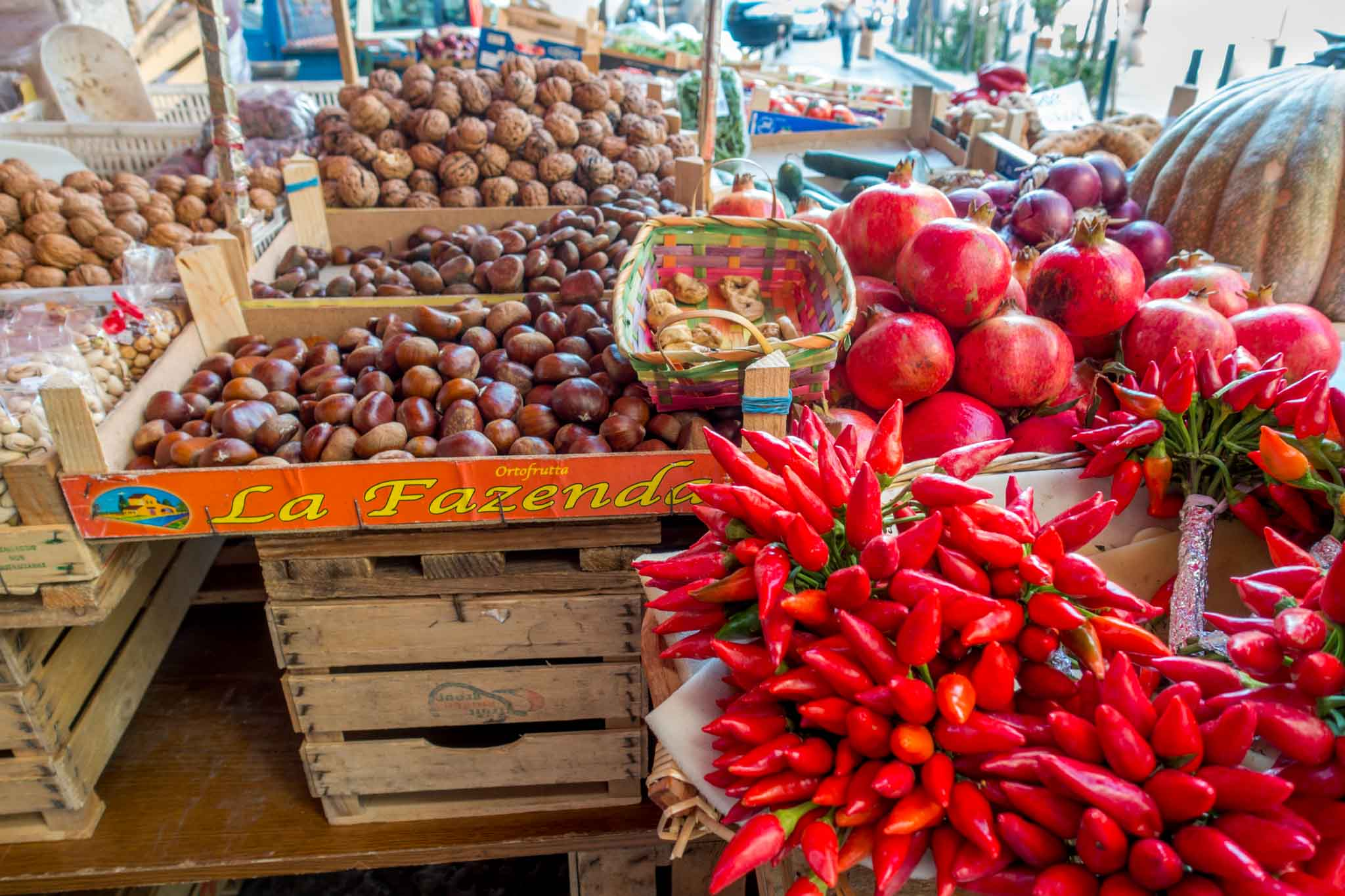Fruit, vegetables, and nuts on display at the Capo market in Palermo Italy