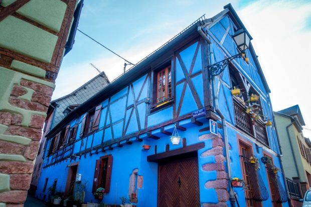 Bright blue half-timbered building in Ribeauville, France