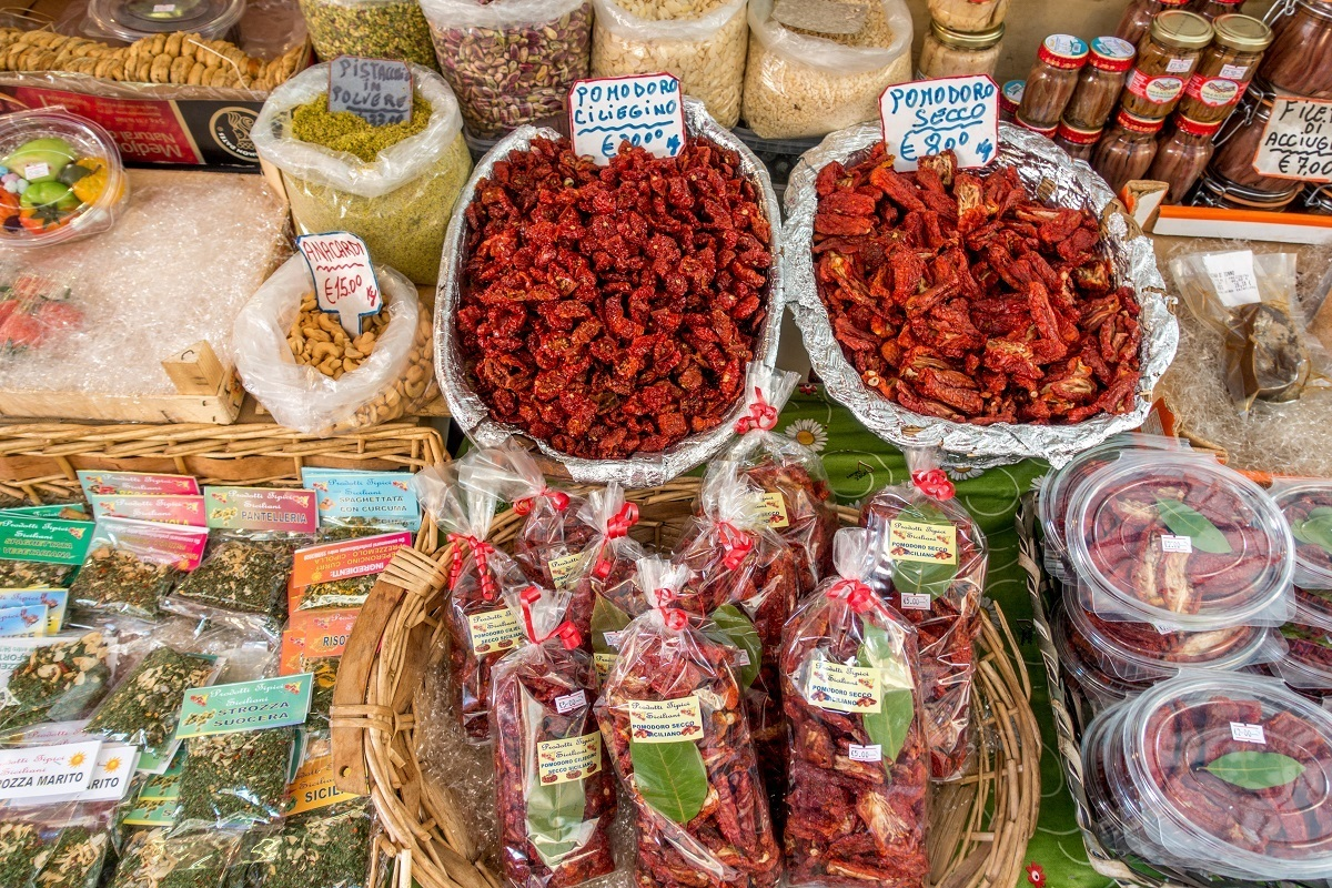 Sundried tomatoes and spices at the Capo market in Palermo, Italy.