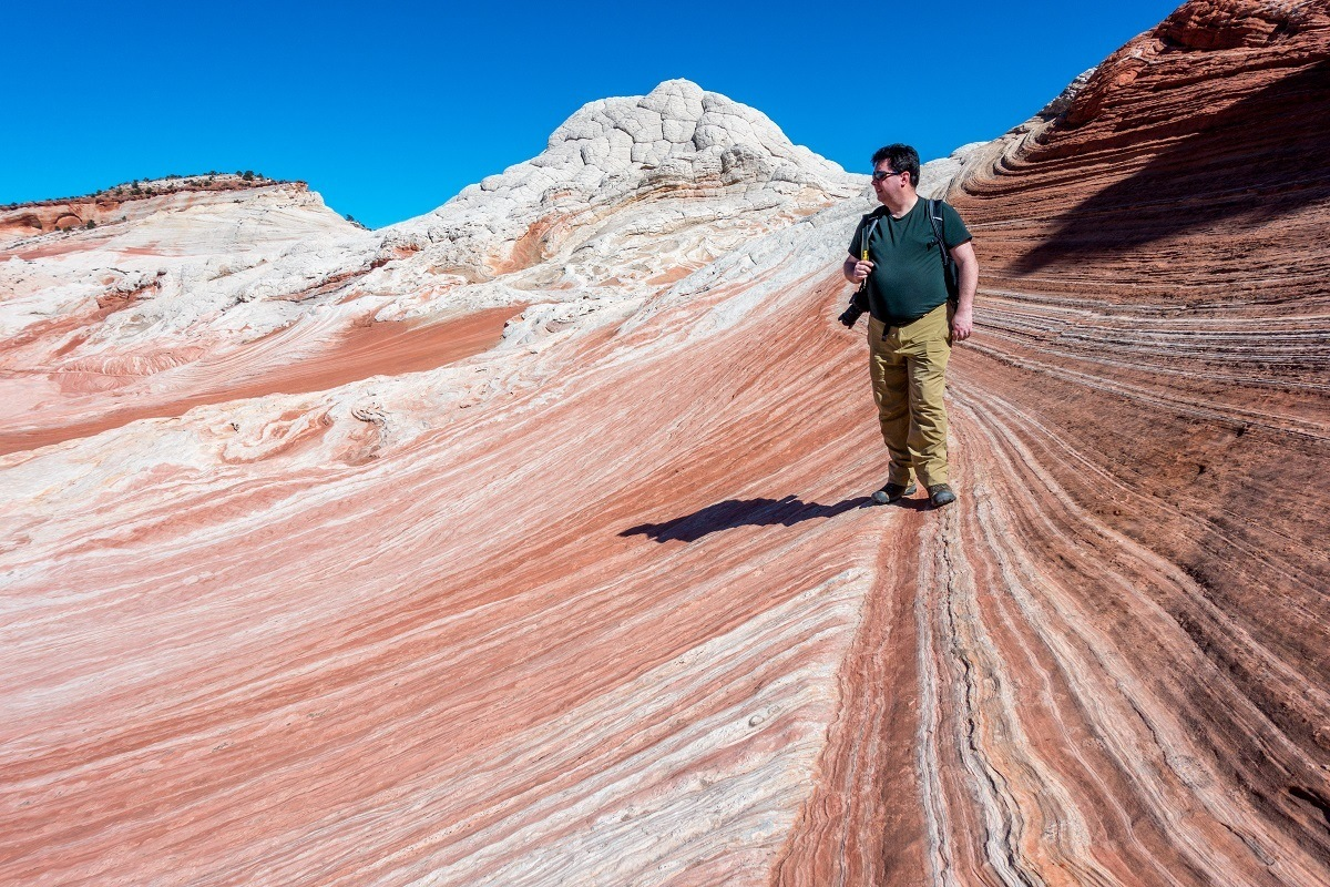 Lance walking in the White Pocket formation of the Vermilion Cliffs National Monument