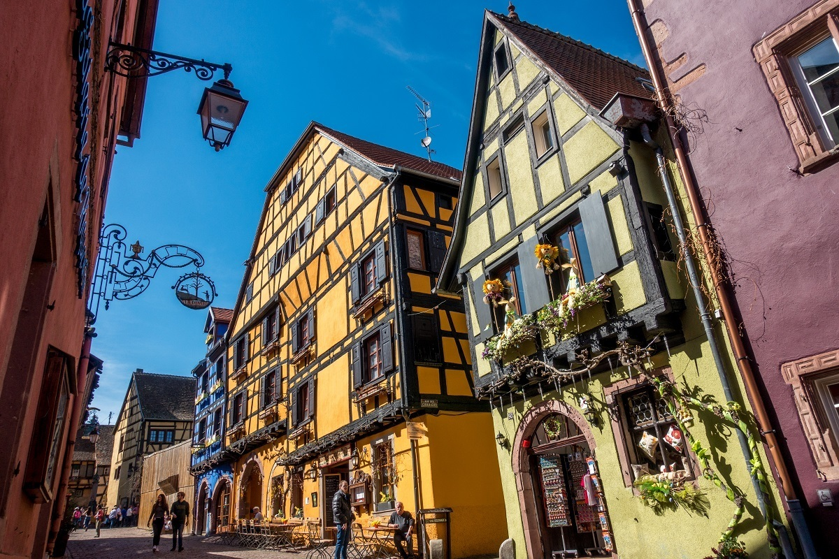 Brightly-colored half-timbered buildings in Riquewihr