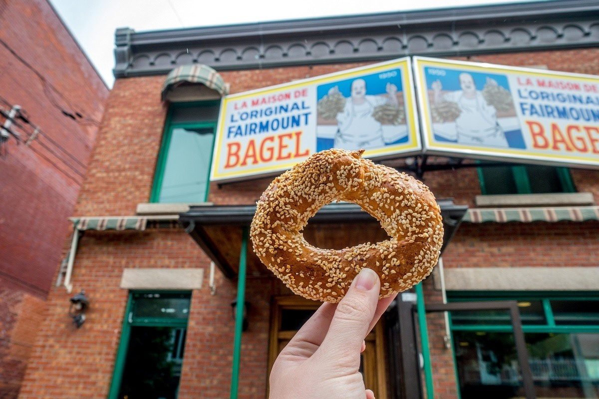 Traditional Montreal bagel in front of bagel bakery