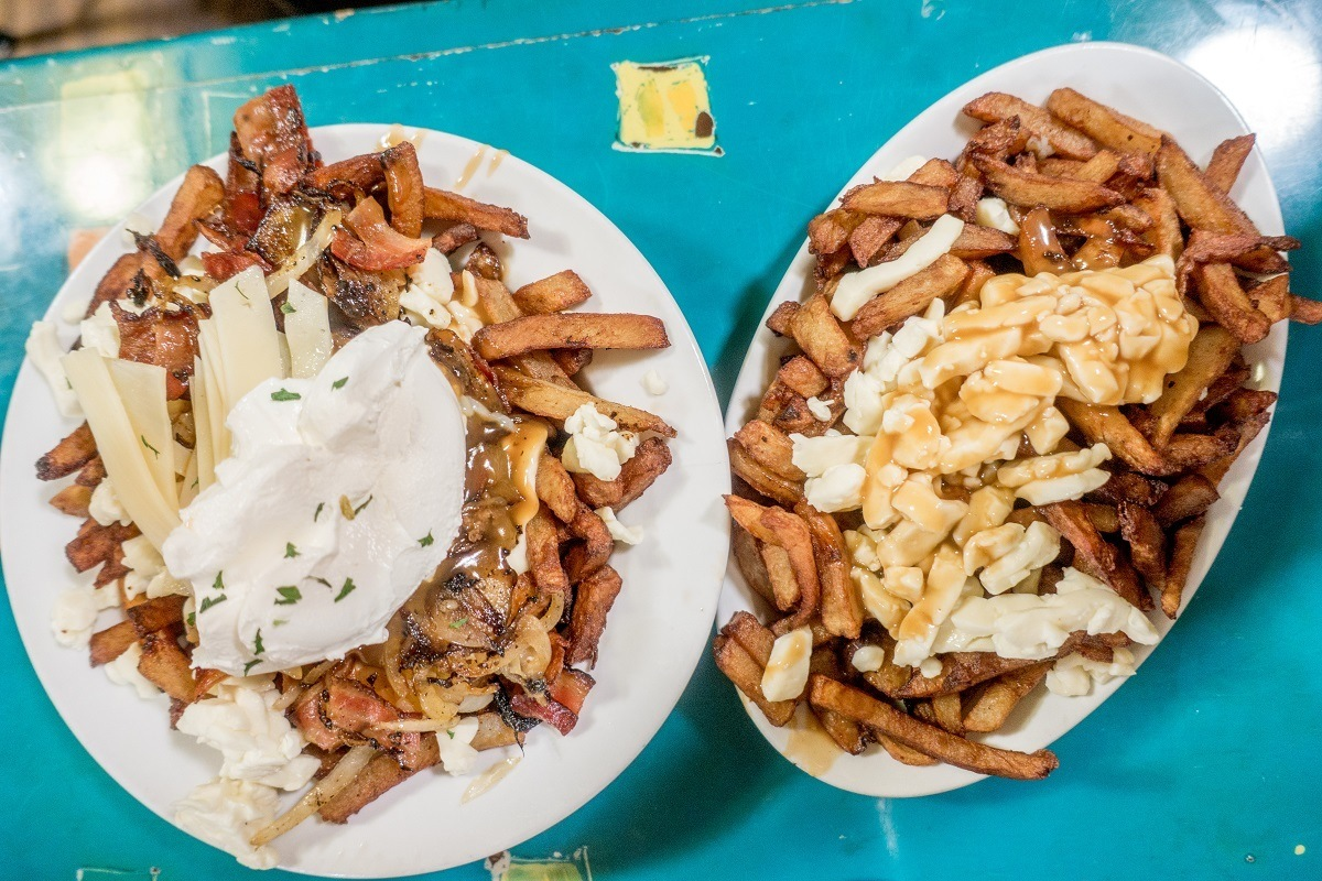 Plates of poutine--French fries with gravy and cheese