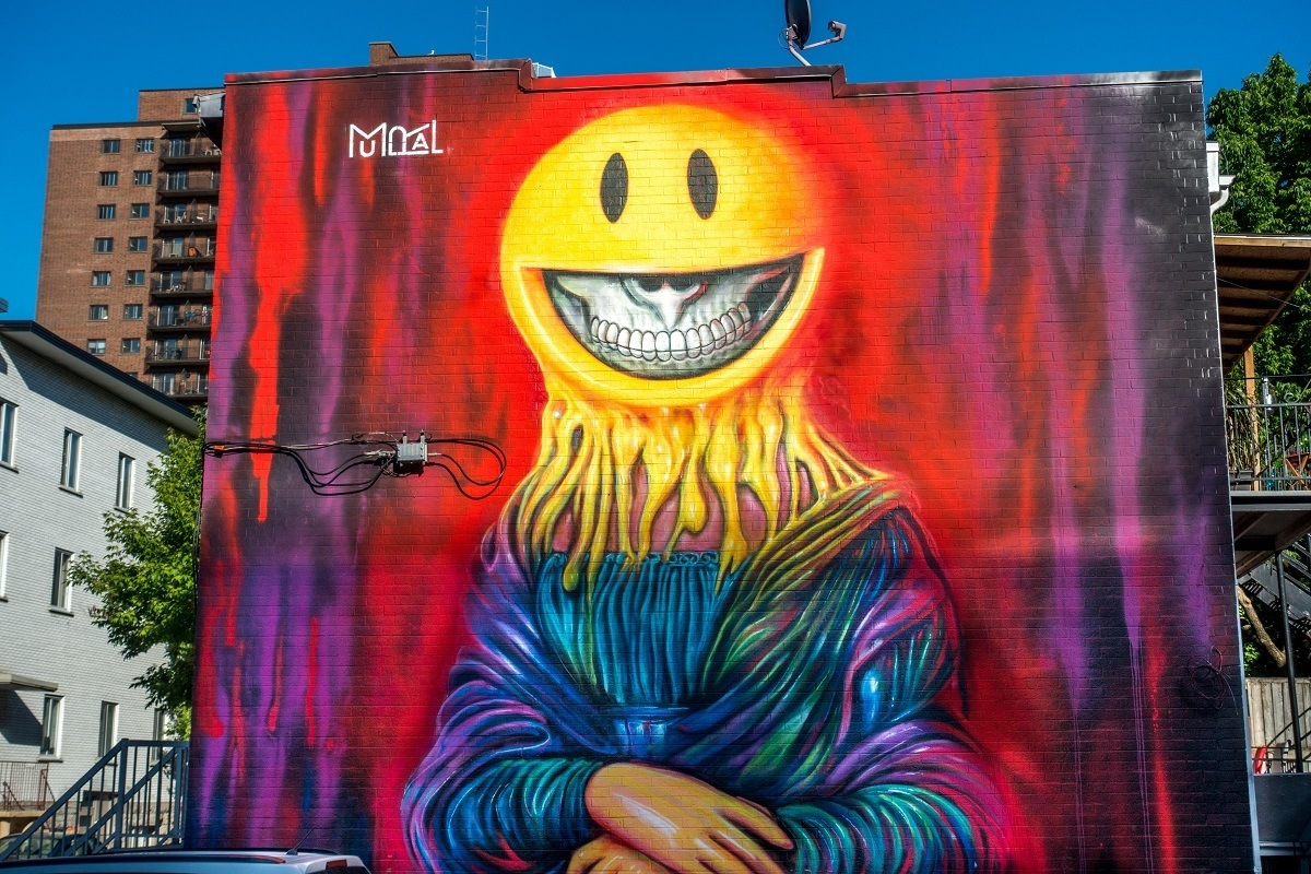 Street art mural with goulish smile