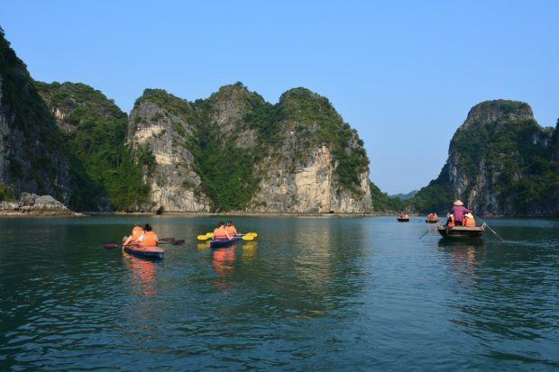 A sea kayak trek in Ha Long Bay, Vietnam.  The definition of trek has expanded from just hiking and walking to including cycling, sailing, kayaking, and a host of other adventure travel options. Active travelers have far more options than just wilderness walking or the mountain trek.