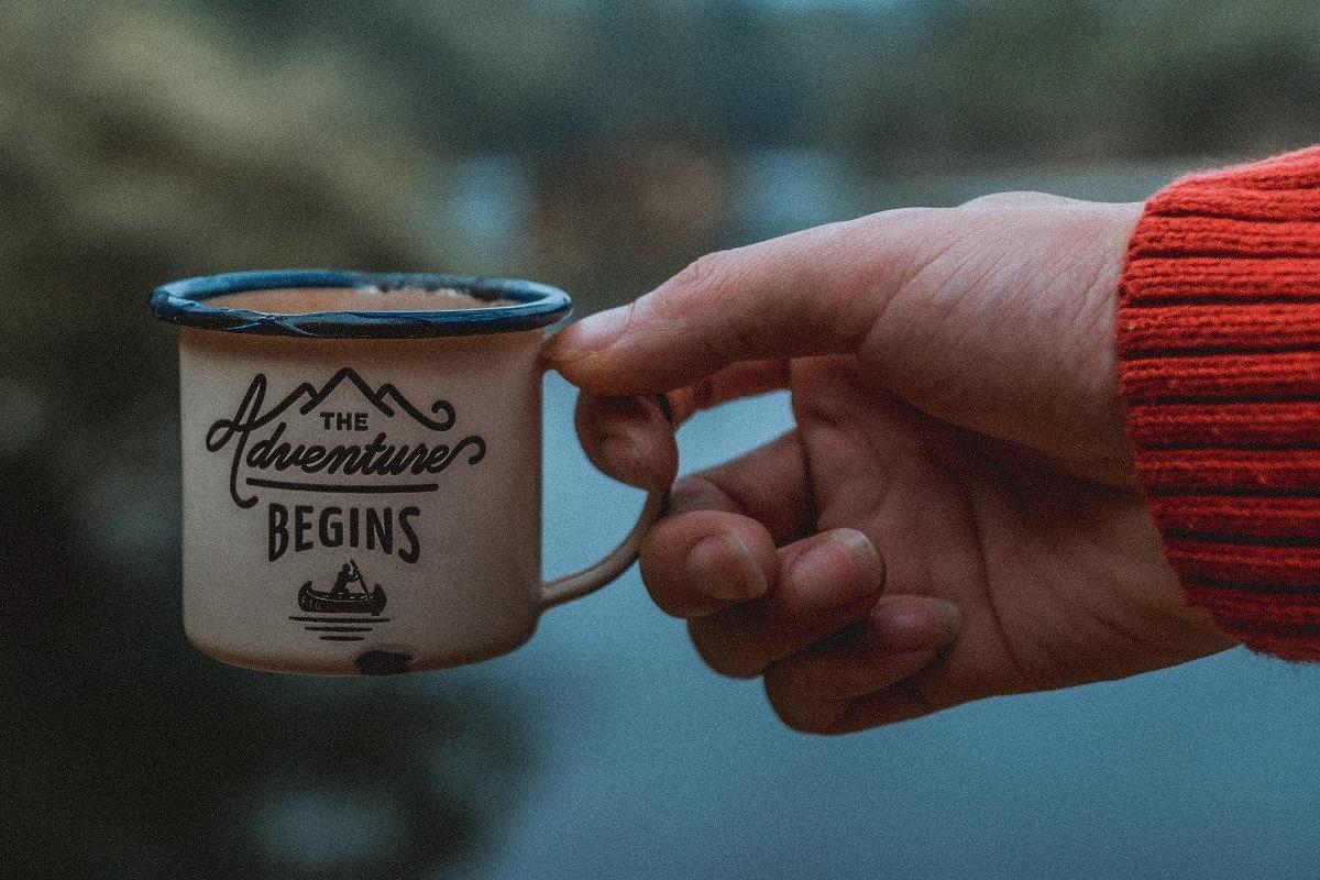 "Coffee mug that says, ""The Adventure Begins"""