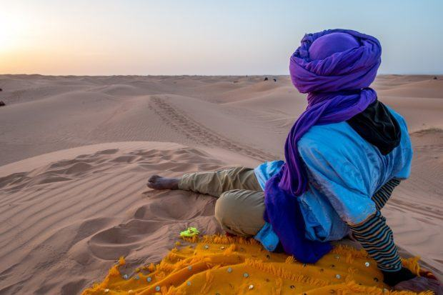 If you're not sure what to see in Morocco, head out to the dunes of Erg Chebbi in the desert with a camel guide