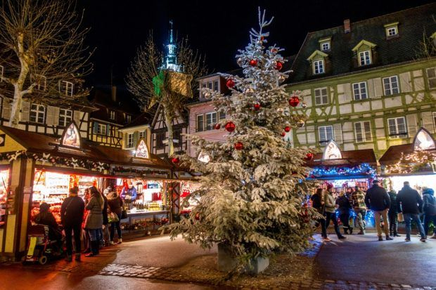 The Colmar France Christmas market is full of food and gift vendors, beautiful decorations, and brilliant lights