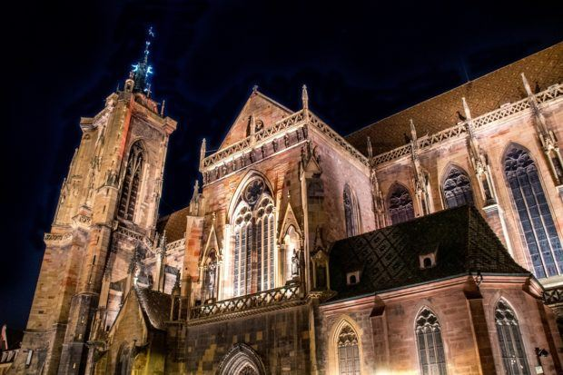 The Collegiate Church of St. Martin in Colmar, France, lit up at night