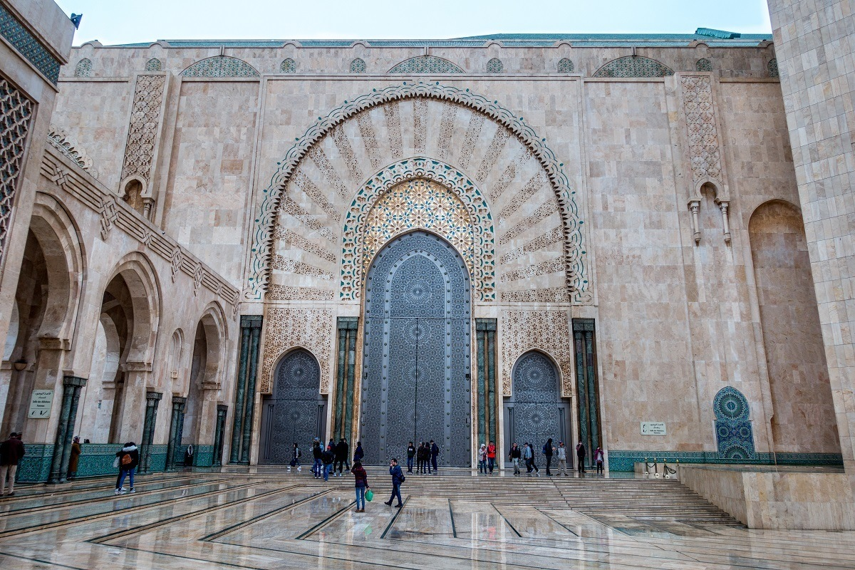 Ornate fascade of Hassan II Mosque in Casablanca, one of the most recognizable Morocco landmarks