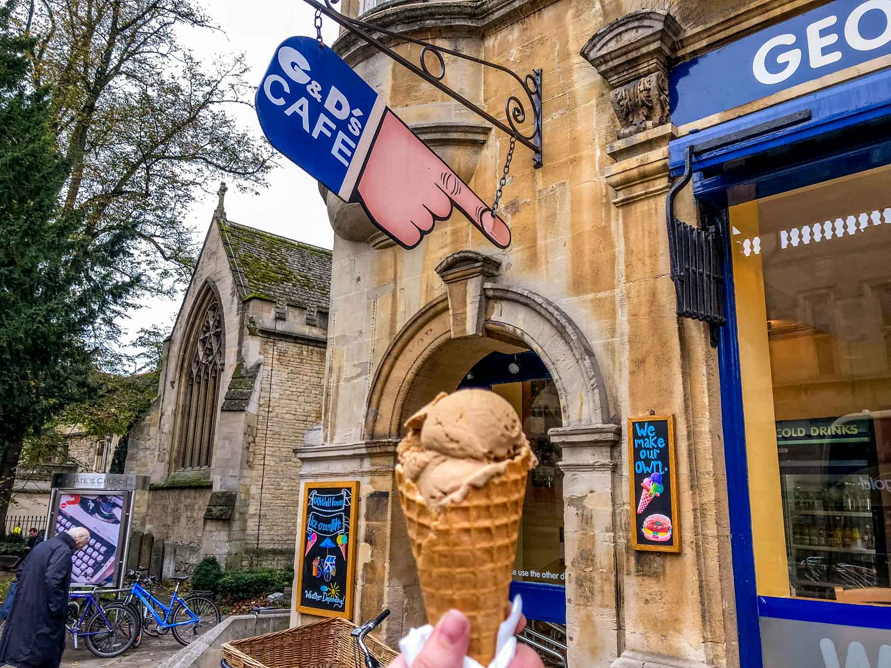 Ice cream cone in front of a hand-shaped sign for G&Ds cafe