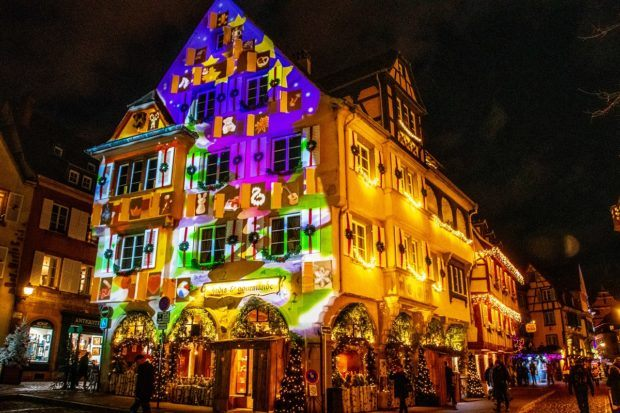 During a Colmar winter, buildings throughout the city have projections of Christmas and winter imagery