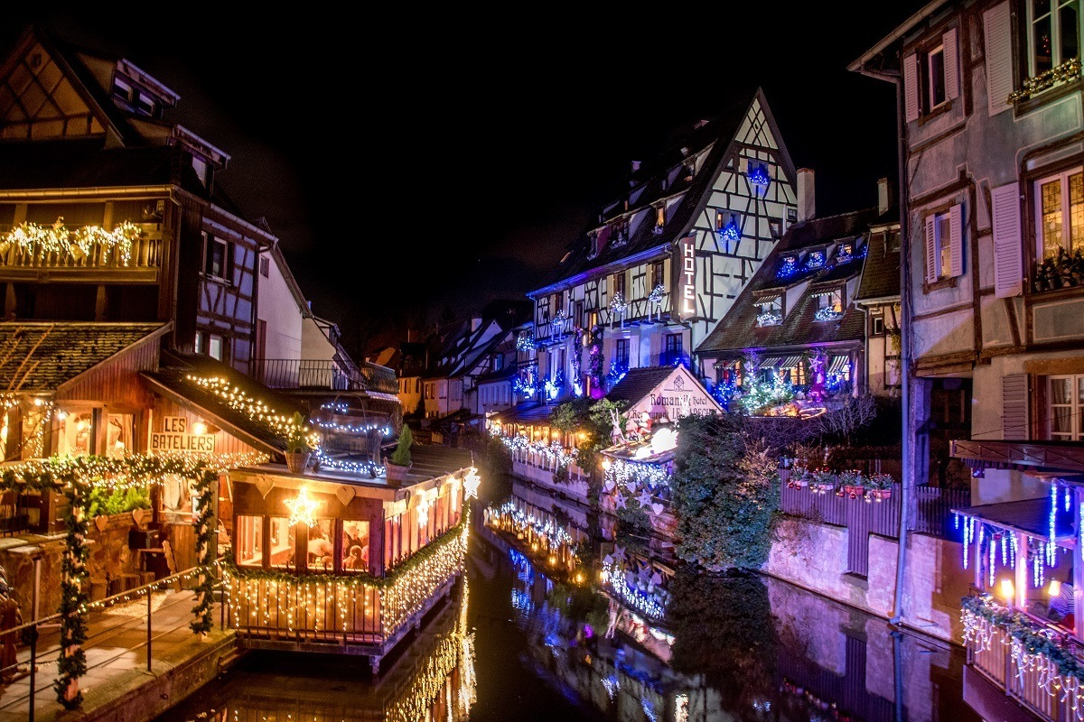 Colorful buildings in Petite Venise covered in Christmas lights