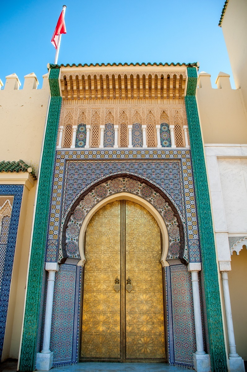 Golden and tiled gates at the Royal Palace in Fez