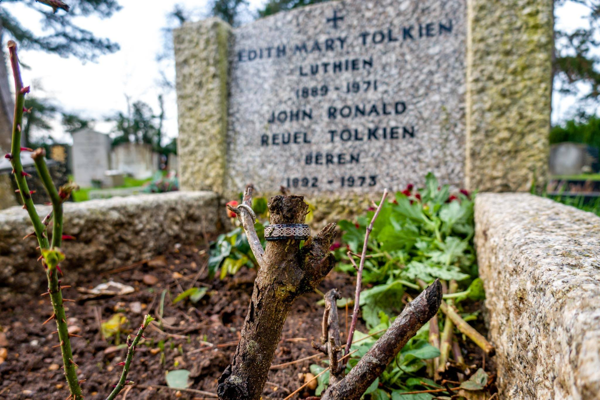Rings around the stalk of a rosebush at the grave of JRR Tolkien and his wife
