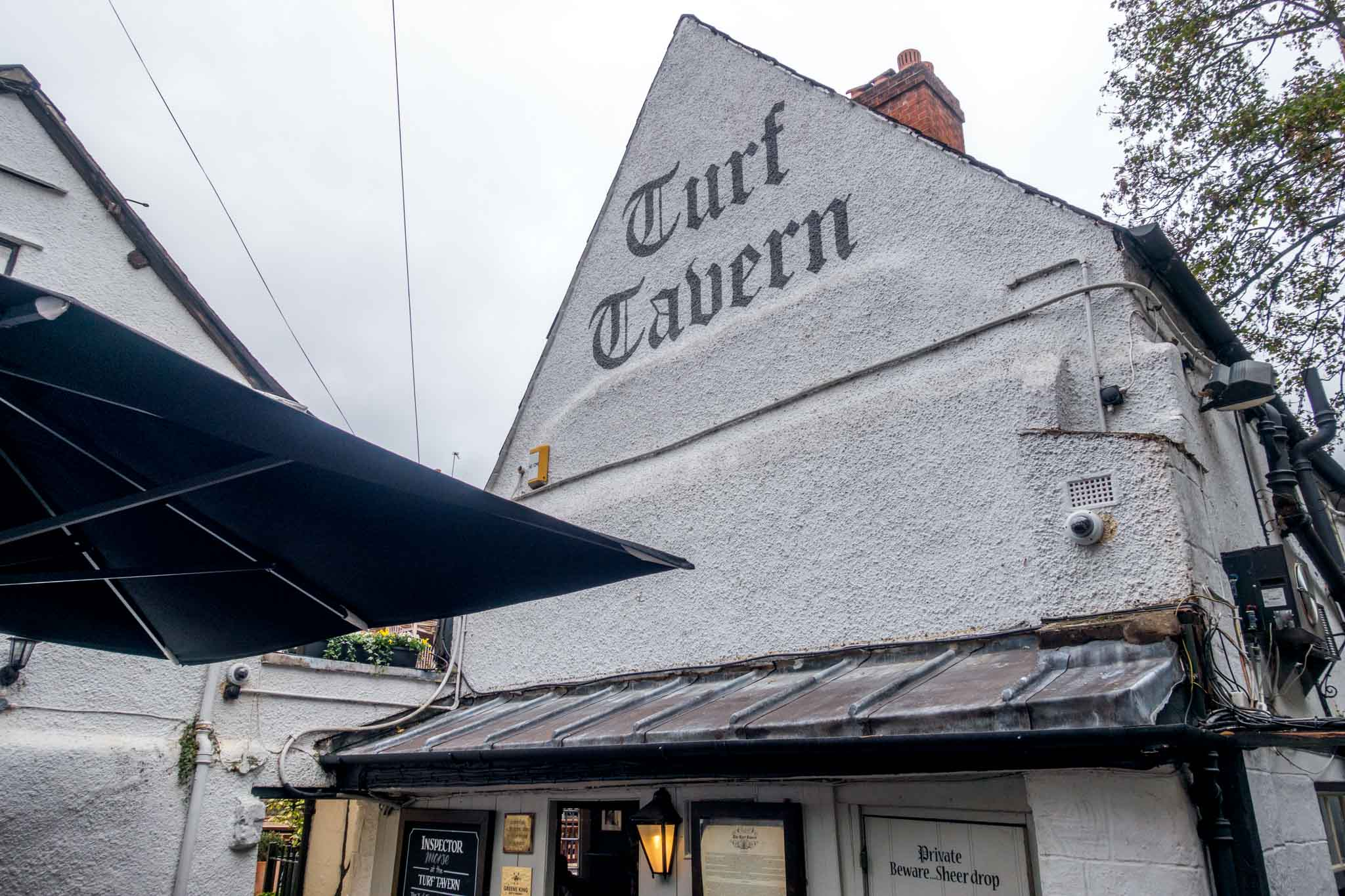 White exterior and sign at the historic Turf Tavern